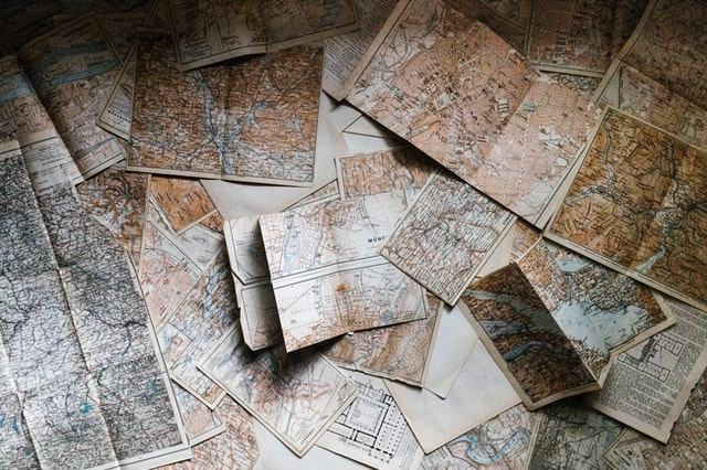 Floor covered with maps.