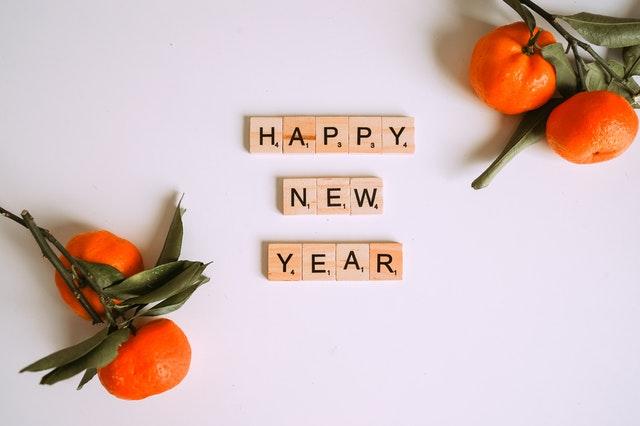 Happy New Year written using scrabble tiles