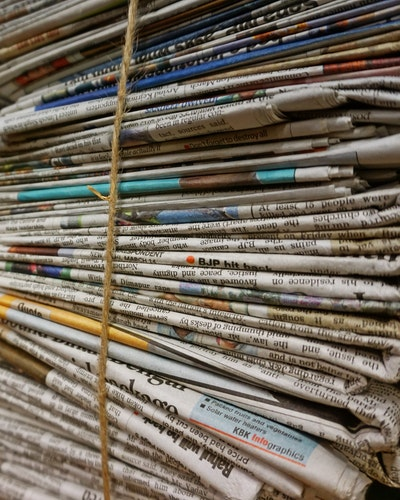 Stacks of newspapers which can be an eco-friendly gift wrapping ides