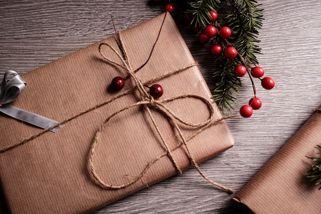 A Christmas present wrapped in an eco-friendly way as one of the eco-friendly tips for christmas
